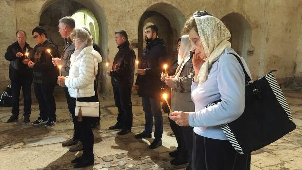 Ukrainian tourists at St. Nick church