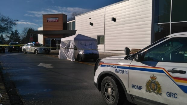 Police officers are on scene at Ridge Meadows Hospital on Friday, and a vehicle is under an IHIT tarp after an early morning shooting left one man dead.