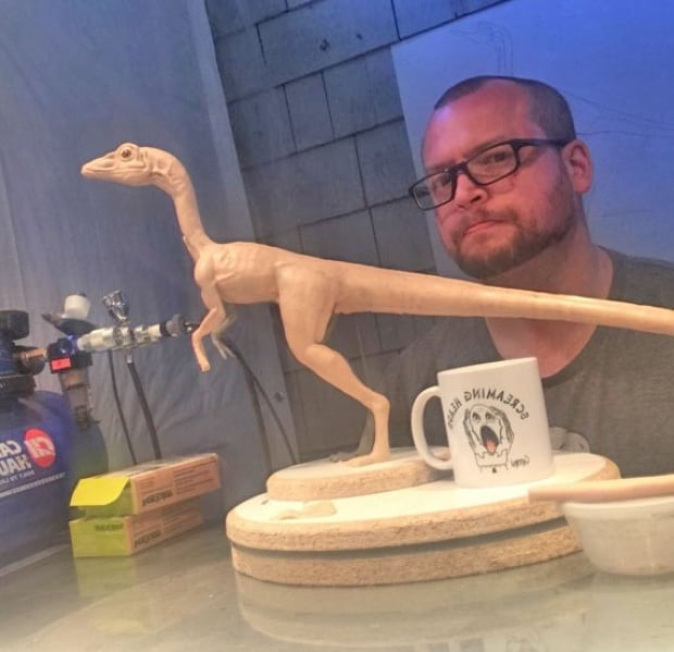 Chris Ruprect with small dinosaur sculpture