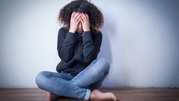 A stock image illustrates a teen girl suffering from depression. A new study has found that girls who went through puberty earlier than most were more likely to become depressed, and their symptoms were also more severe in adolescence.