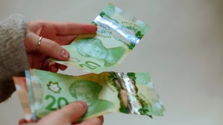 cash money currency economy Canadian dollars