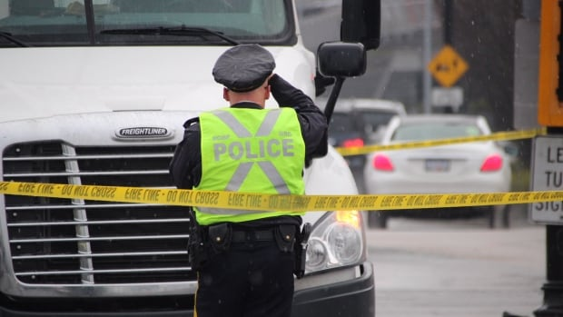 Mounties in Richmond are investigating after a female pedestrian was struck by a Canada Post semi truck on Wednesday.