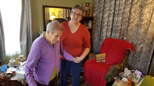 Margaret Stewart, right, is unhappy with Nova Scotia Power because she says the company didn't call her to tell her that an electrical wire that was sitting on top of her car had electricity running through it.