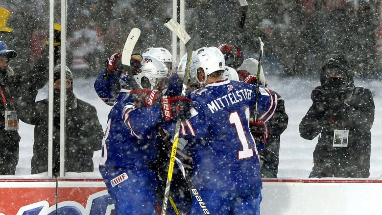 f02df456a4f U.S. players celebrate a goal during their 4-3 shootout win over Canada in  an outdoor game in Orchard Park, N.Y. on Friday. (Adrian Kraus/Associated  Press)