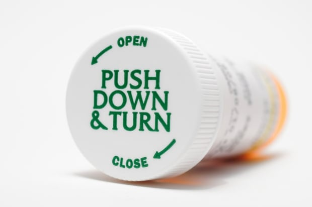 Push and turn pill bottle cap
