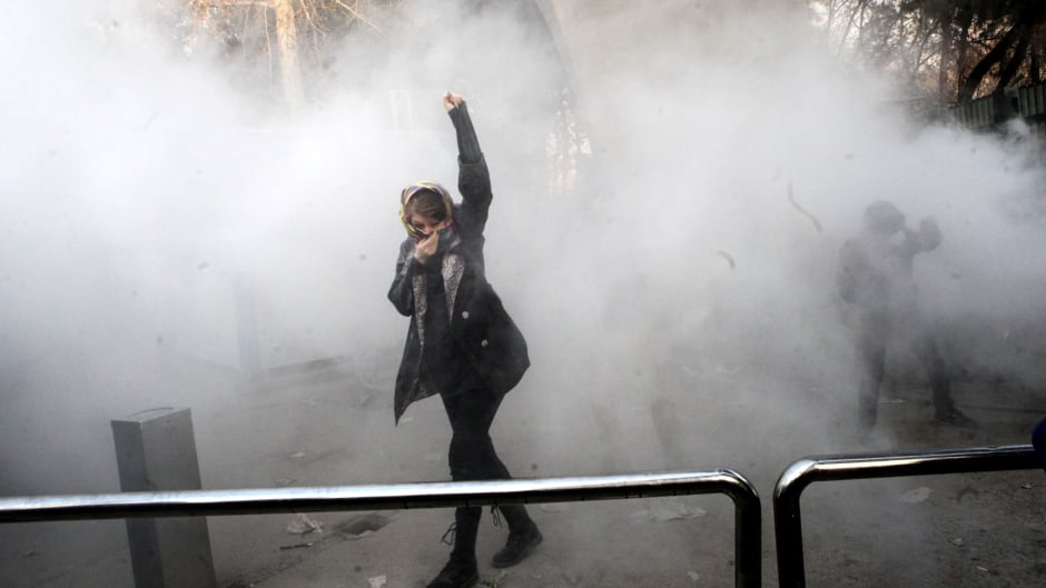 Iranian students clash with riot police during an anti-government protest around the University of Tehran, Dec. 30, 2017.
