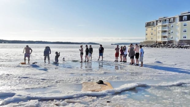 It was a frigid day for a dip in the Charlottetown Harbour, but dozens of Islanders lined up to do just that Monday.