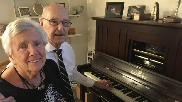 Dolf Hantelmann, pictured here with his wife Tori, has been tuning pianos in Edmonton for more than 50 years.