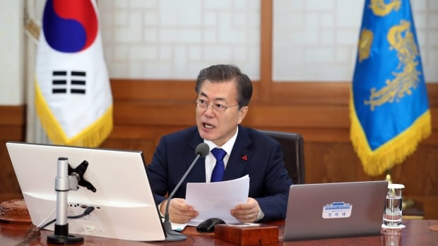 South Korean President Moon Jae-in speaks during a cabinet meeting at the presidential Blue House in Seoul on Tuesday. South Korea on Tuesday offered high-level talks with rival North Korea to find ways to co-operate on next month's Winter Olympics in the South.
