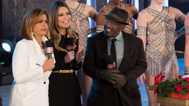 Hoda Kotb, at left, is seen with Today show colleagues Savannah Guthrie and Al Roker at the Rockefeller Center Christmas Tree lighting ceremony in November. Kotb has filled in as co-anchor since Matt Lauer was fired after a sexual misconduct investigation.