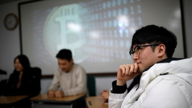 Eoh Kyung-hoon, leader of a club studying digital currencies, attends a meeting at a university in Seoul, South Korea, where the government has announced rules to limit bitcoin's market freedom.