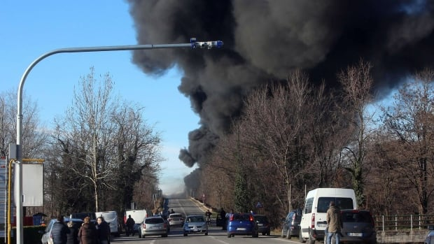 Black smoke rises from the scene of the crash in northern Italy, reportedly from a tanker truck carrying flammable liquid.