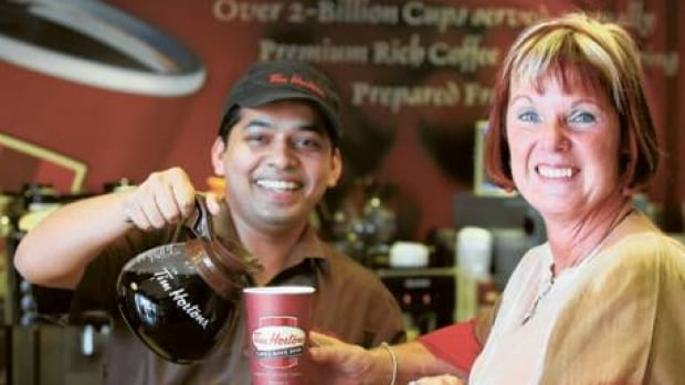 Jeri Lynn Horton-Joyce, daughter of Tim Horton, is served in the Shaikh Zayed Road location in Dubai. This photo was taken for a story published in the Gulf News, a daily English language newspaper in Dubai.