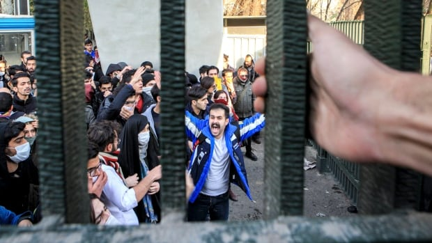 In this Dec. 30, 2017 photo, taken by an individual not employed by The Associated Press and obtained by the AP outside Iran, university students attend an anti-government protest inside Tehran University. This unrest appears to be fuelled by anger over a faltering economy, unemployment and corruption.