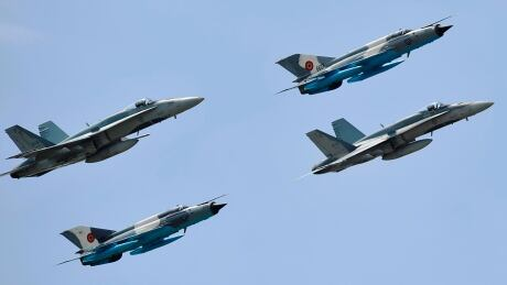 CF-18s and Romanian MiGs