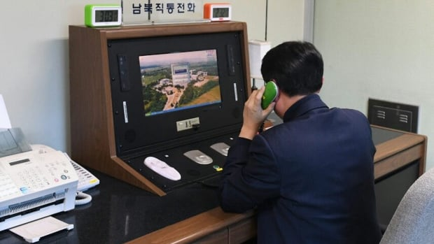 A South Korean government official checks the direct communications hotline to talk with the North Korean side at the border village of Panmunjom in Paju, South Korea, on Wednesday.