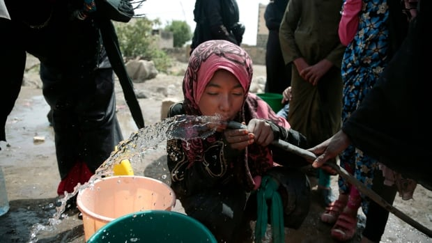 A girl drinks water from a well that alleged to be contaminated water with the bacterium Vibrio cholera, on the outskirts of Sanaa in July. Yemen's raging two-year conflict has served as an incubator for lethal cholera.