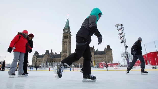 People brave the frigid weather to skate on an outdoor rink on Parliament Hill in Ottawa on Dec. 29.