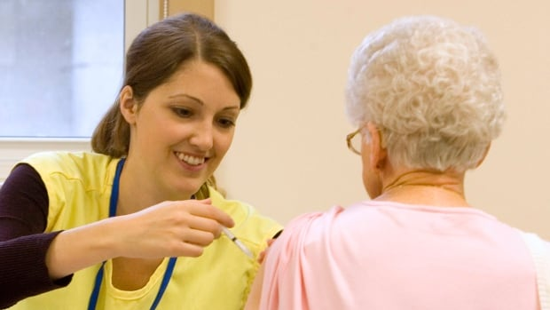 Registered nurse Shannon Haskell administers H1N1 vaccination to an elderly woman in Lakefield, Ont., in 2009. Advocates for seniors are calling for a new vaccine to protect against shingles that will be available across Canada in mid-January to be provided for free.