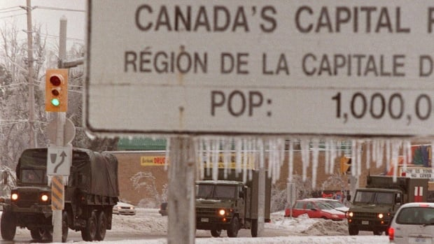A military convoy leaves Ottawa for Osgoode Township on Jan. 6, 1998, to help crews return power to residents affected by the ice storm.
