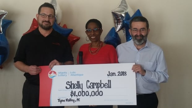 Shelly Campbell and her husband, Jim, right, received the $1 million cheque Wednesday from John Arsenault of Red Shores in Summerside.