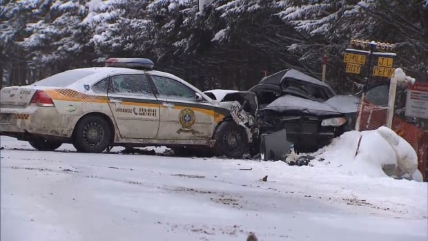 A 63-year-old man and a 58-year-old woman were killed when an SQ police cruiser collided with an oncoming vehicle while the officer was heading to the scene of a car accident near Saint-Rémi-d'Amherst, Que.