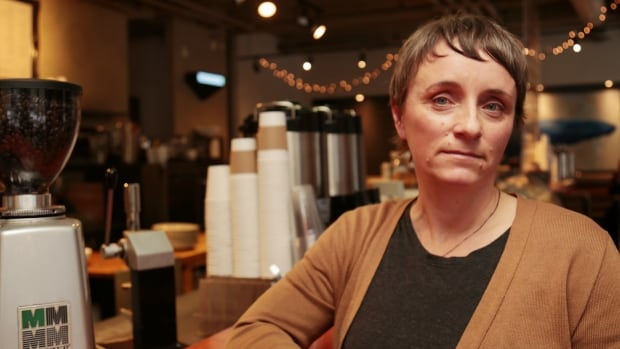France Desfossés, co-owner of Planet Coffee in Ottawa's ByWard Market worries the province's minimum wage hike could make her business unprofitable.