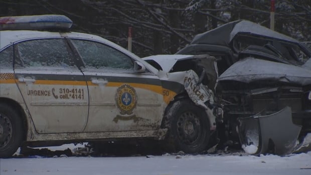 Two people have died after their car was hit by a Quebec police vehicle on Highway 323 near Amherst, Que., on Wednesday, Jan. 3, 2018.