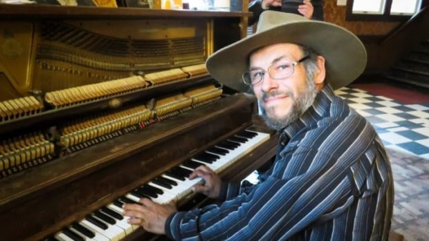 Dwayne Kelly regularly plays ragtime piano at the Downtown Hotel in Dawson City. His home was destroyed in a fire last weekend. Kelly says he also burned some of his fingers, but he can still play.