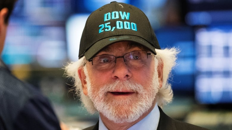 fe3df53997e Trader Peter Tuchman wears a hat as the Dow Jones industrial average rises  above 25