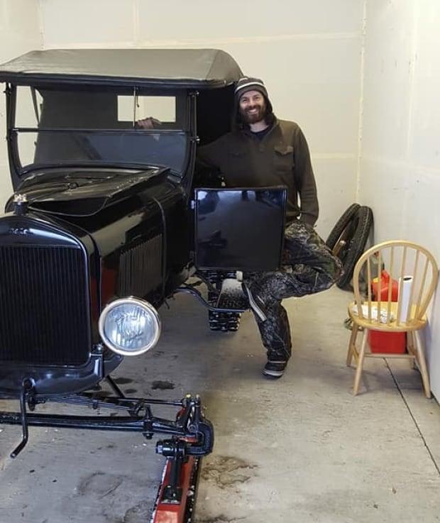 Jamie Brake poses with Model T