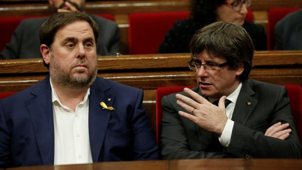 Oriol Junqueras, left, is seen Oct. 26 with former Catalan President Carles Puigdemont. The former Catalan vice-president has been detained, while Puidgemont and other politicians fled Spain in early November.