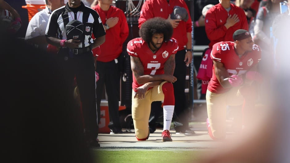 Colin Kaepernick, while quarterback of the San Francisco 49ers, kneels for the U.S. national anthem before a game on Oct. 23, 2016 in Santa Clara, Calif.