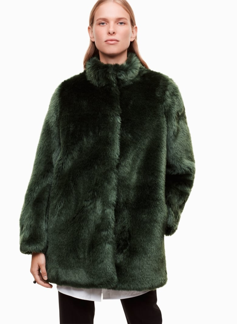 66f4222bdcd42 Incredibly luxe and bearing a striking emerald hue, this plush faux fur  coat effortlessly defies the myth that cozy clothes belong indoors and  under ...
