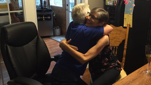 Storm Miller received an assisted death in her home in August of 2016 and is seen here hugging a friend on the morning of her death.