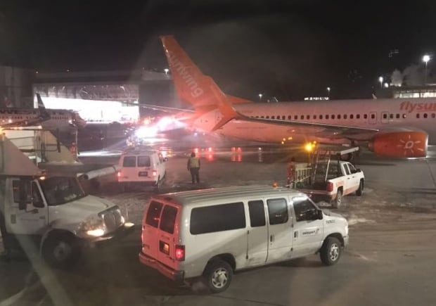 Passengers forced to evacuate burning plane after collision at Toronto airport