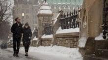 Ottawa winter weather - Couple walking on Parliament Hill