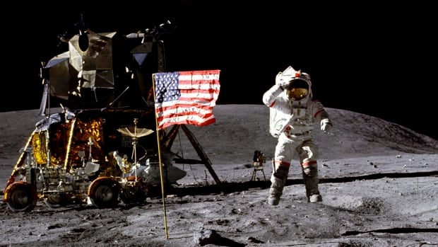 In this April 1972, John Young salutes the U.S. flag at the Descartes landing site on the moon during the first Apollo 16 extravehicular activity. NASA says the astronaut, who walked on the moon and later commanded the first space shuttle flight, died on Friday at 87.