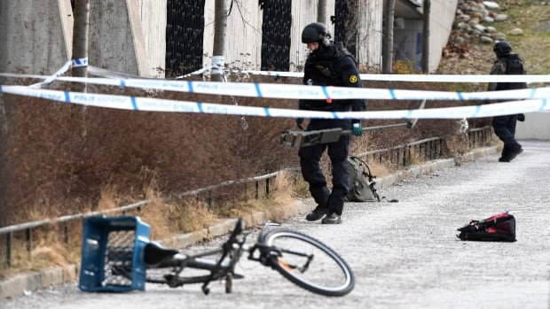 Swedish police search the area outside the Varby Gard subway station in Stockholm following the explosion.