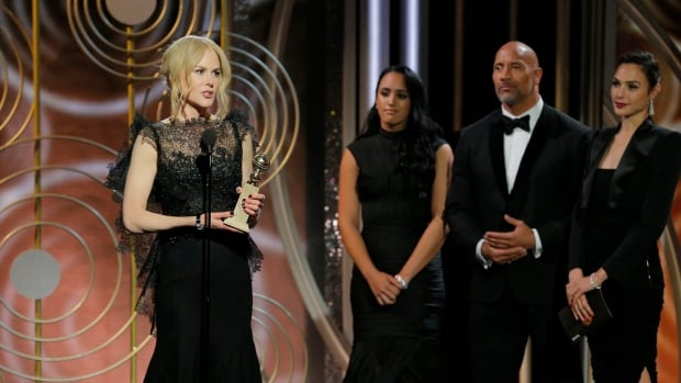 Nicole Kidman, left, accepts one of several awards won by Big Little Lies at the 75th Annual Golden Globe Awards Sunday night.