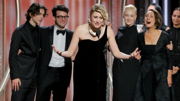 Writer/director Greta Gerwig accepts the award for best picture, comedy or musical, for Lady Bird at the 75th Golden Globe Awards.