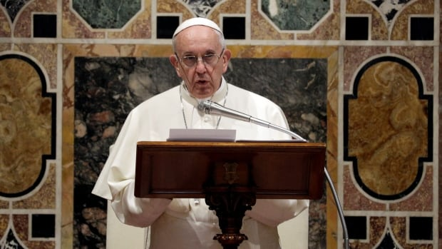 Pope Francis talks to diplomats during the traditional exchange of the New Year greetings in the Regal Room at the Vatican on Monday.