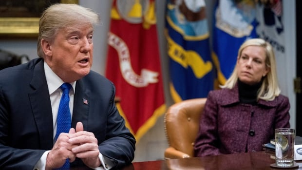 U.S. President Donald Trump, accompanied by Secretary of Homeland Security Kirstjen Nielsen, speaks during a meeting with Republican Senators on immigration in the Roosevelt Room at the White House in Washington last week.