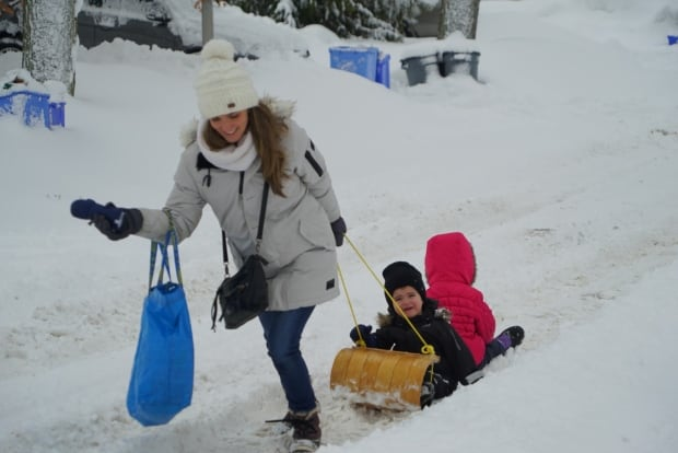 Mom pulling kids in snow, London, Ont.