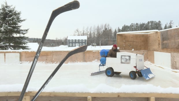 Volunteer rink workers at the Estey's Bridge community hockey rink have built a small, Zamboni-like ice-clearing machine out of an old lawnmower.