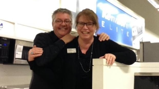 Leonard Gibbins and co-worker Melanie Batsford in the appliances department at Sears in happier days.