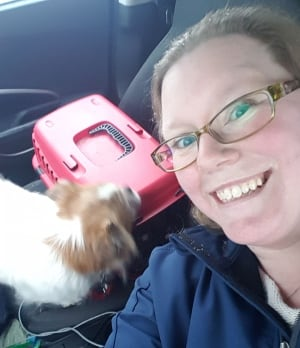 Kelsey Fillmore and her dog, Fenway, on their way to the Hampton Inn