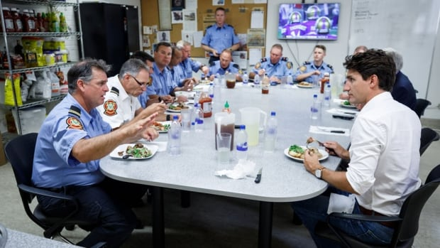 Prime Minister Justin Trudeau eats lunch with firefighters on July 28 in Winnipeg.