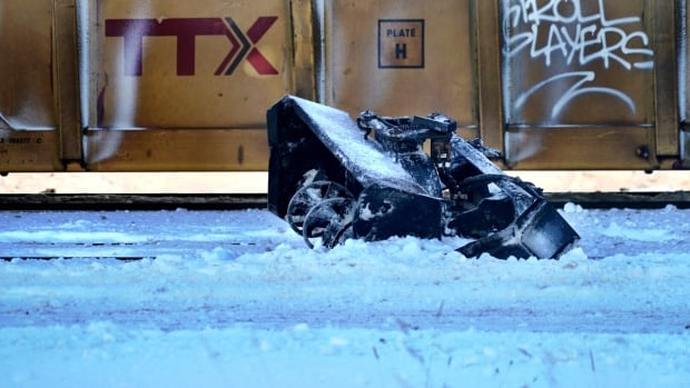 Downtown collision between freight train, sidewalk snowplow leaves one dead