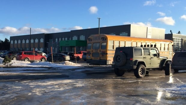 Bus drivers and parents wait for school to be dismissed at Gander Elementary in January. Students at the school have been complaining of the powerful smell of a nearby sewage treatment plant.